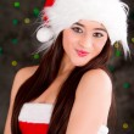 Beautiful sexy girl wearing santa claus clothes — Stock Photo