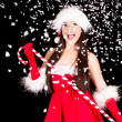 Young and sexy woman in santa costume with snow — Stock Photo #14813181