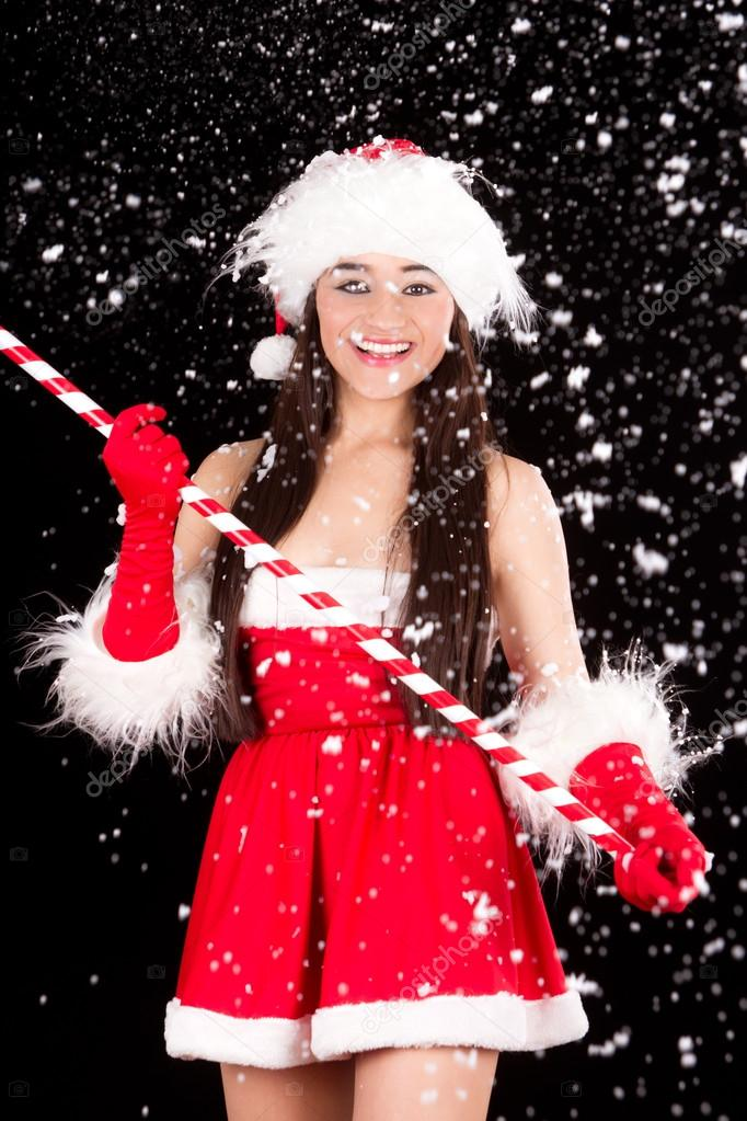 Young and sexy woman in santa costume with snow — Lizenzfreies Foto #14813241