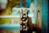 Gears from old mechanism with chain, shallow DOP — Stock Photo