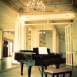 Grand piano in a old vintage luxury interior — Stock Photo #16796871