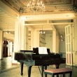 Stock Photo: Grand piano in old vintage luxury interior
