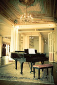 Grand piano in a old vintage luxury interior — Stock Photo