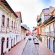 Streets of CuencEcuador during festivities with city flags — Stock Photo #16885609