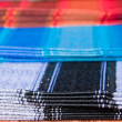 Stock Photo: Ecuadoritraditional fabrics, Otavalo market