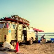 Hippie Surfboard Van on the beach — Stock Photo #19508375
