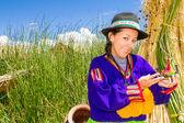 Woman, in indian costume on Uros island Peru — Stock Photo