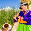 Woman, in indian costume on Uros island Peru — Stock Photo