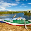 Royalty-Free Stock Photo: Blue lake with boats at the shore, titicaca lake
