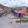 Street, old town of Quito, Ecuador, with city flag — Stock Photo