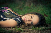 Calm woman laying in the park — Stock Photo
