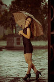 Женщина с зонтиком — Стоковое фото