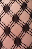 Close up of Caucasian woman in pattern stockings — Stock Photo