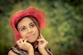 Portrait of beautiful woman holding her hat down — Fotografia Stock