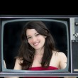 Woman inside an empty television screen — Stock Photo