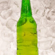 Cold beer bottle with ice - Stock Photo