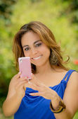 Woman messaging on her smart phone — Stock Photo