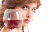 Beautiful brunet girl drinking red wine isolated — Stock Photo