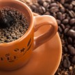 Stock Photo: Coffee cup with fresh coffee beans