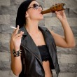 Woman having a beer drink and a smoke. — Stock Photo