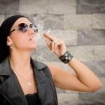 Gang woman smokes on the street, selective focus — Stock Photo