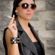 Gang woman smokes on the street, selective focus — Stock Photo