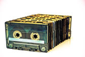 Row of audio tapes COLOR PROCESSED POP — Stock Photo