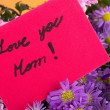 Mother day greeting, love you mom, handwritten. - Stock Photo