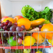 Stock Photo: Fresh fruits and vegetables in kitchen cabinet