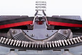 National written on an old typewriter . — Stock Photo