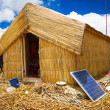 Hut with solar panels, regenerative energy system - Stock Photo