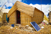 Hut with solar panels, regenerative energy system — Stock Photo