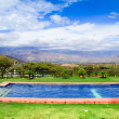 Swimming pool with a view of the andes mountains — Stock Photo