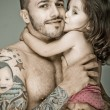 Постер, плакат: Father and daughter man with tattoo