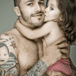 Stock Photo: Father and daughter, mwith tattoo