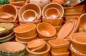 Ceramic pots and utensils displayed for sale — Stock Photo