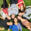 Stockfoto: Group of hispanic friends laying down in park