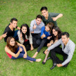Foto Stock: Group of hispanic teens thumbing up outdoors
