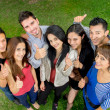 Stok fotoğraf: Group of teens thumbing up outdoors