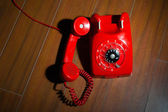 Rotary telephone on wooden background — Stock Photo