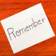 Remember - Post it Note on Wood Background — Foto Stock #26780661