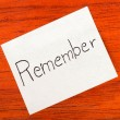 Stock Photo: Remember - Post it Note on Wood Background