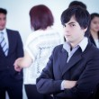 Alternative business man in front of a group — Stockfoto