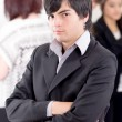 Alternative business man in front of a group — Stock Photo