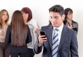 Hispanic man using a cellphone with peers — Stock Photo