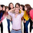 Eight Girls kissing a stressed man — Photo