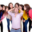 Eight Girls kissing a stressed man — Stockfoto