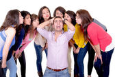Eight Girls kissing a stressed man — Stock Photo