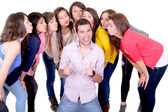 Eight young women kissing handsome man — Stock Photo