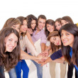 Teamwork: Group of diverse joining hands — Stock Photo #27435053